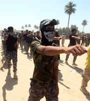 Volunteers in Baghdad prepare on Wednesday to join the Iraqi army's fight against the Islamic State in Iraq and Syria. Iraq on Tuesday said militant insurgents seized a university holding nearly 90 pounds of uranium materials.