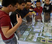 Students look at a model of a Russian nuclear power plant at a 2012 international exhibition in Hanoi. Some U.S. House lawmakers on Thursday voiced reservations about a nuclear-trade pact the Obama administration has signed with Vietnam.