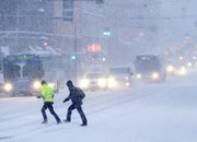 People cross a snow-covered road in Helsinki in February 2012. The Finnish capital could play host in September or December to a multinational conference on banning weapons of mass destruction from the Middle East.