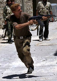 A Syrian rebel fires a weapon on Tuesday during a battle with government soldiers in the city of Aleppo. Canada said it is providing a multimillion-dollar assistance package intended to help protect Jordan from a potential Syrian biological or chemical strike (AP Photo/Aleppo Media Center).