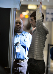 "An airline passenger goes through a full-body scan at O'Hare Airport in Chicago in 2010. U.S. Attorney General Eric Holder says recent intelligence about an alleged al-Qaida plot to smuggle a new type of bomb onto a U.S.-bound aircraft is perhaps ""more frightening"" than anything else he has seen while in office."