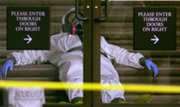 An emergency response worker rests on the steps of a U.S. Senate office building during anthrax contamination tests at the U.S. Capitol in 2001. An Agriculture Department probe has revealed safety lapses involving anthrax bacteria at the Centers for Disease Control and Prevention in Atlanta.