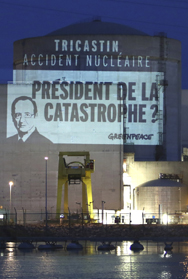 Activists project an image on a building at the Tricastin nuclear power plant after breaking into the French facility on Monday (AP Photo/Greenpeace).