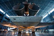 The U.S. space shuttle Discovery, seen on display at the Smithsonian National Air and Space Museum. The end of U.S. space shuttle launches in 2011 has boosted the cost of fuel for U.S. and British long-range missiles.