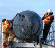 Technicians prepare a U.S. Ground Based Interceptor for placement at an Alaska launch facility in 2012. The Defense Department might soon schedule a new test of a GBI variant that missed an intercept target in a trial launch earlier this month, a high-level Pentagon official said on Wednesday (U.S. Missile Defense Agency photo).