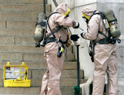 Emergency response crews in Washington assess materials in 2006 for the presence of anthrax bacteria. Lawmakers have voiced skepticism over a U.S. health agency's promise to remedy problems behind an anthrax incident and other recent safety lapses.
