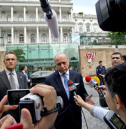 French Foreign Minister Laurent Fabius, center, addresses journalists upon arriving at the Coburg Palais in Vienna on Sunday for a multilateral meeting on Iran's nuclear program. Western nations may offer Iran fast relief from economic sanctions if it agrees to additional limitations on its nuclear work, diplomats said.