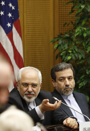 Iranian Foreign Minister Mohammad Javad Zarif, left, and Iranian Ambassador to Austria Hassan Tajik attend nuclear negotiations with six other countries in Vienna on Tuesday. Iran reportedly hinted that resolving an entrenched atomic dispute may be necessary for Tehran and Washington to coordinate against extremists in Iraq.