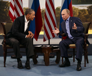 President Obama meets last month with Russian President Vladimir Putin in Northern Ireland. Obama reportedly might cancel an upcoming meeting with Putin amid growing tensions between their governments (AP Photo/Evan Vucci).