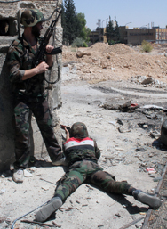 Syrian government troops fire at rebel fighters in a Damascus suburb on Sunday. Lawmakers and issue experts expressed varying opinions on Wednesday about how possible U.S. steps to intervene in Syria's civil war might affect the security of chemical weapons held by the Assad regime (AP Photo/Bassem Tellawi).