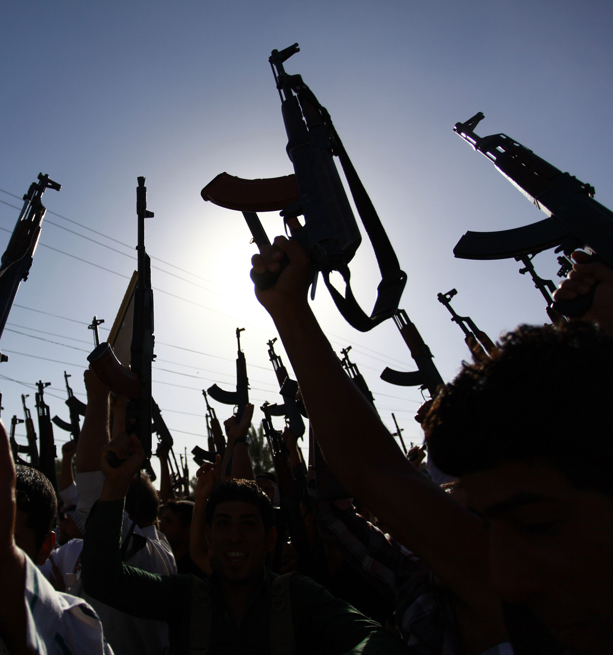 Iraqi Shiite tribesmen brandish weapons in a Tuesday display of solidarity against invading militants. Islamic extremists have seized an Iraqi facility once used by Saddam Hussein's regime to manufacture chemical-warfare materials.