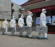 Health workers in China train in 2013 to respond to human infections of avian influenza. The U.S. Centers for Disease Control and Prevention may have discarded materials needed to determine how it accidentally shipped out a dangerous form of avian flu, a spokesman said on Monday.