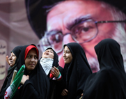 Iranian women pass a portrait of supreme leader Ayatollah Ali Khamenei outside the former U.S. Embassy in Tehran in 2012. Khamenei appears to have offered no concessions in an international standoff on Iran's uranium-enrichment capabilities, according to experts.