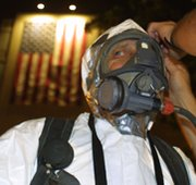 A hazardous-materials worker responds to a report of a powdery substance found in Florida during the 2001 anthrax scare. The former leader of a federal bioterrorism laboratory that mishandled anthrax bacteria has resigned his position at the Centers for Disease Control and Prevention in Atlanta.