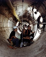Workers inspect equipment at the Waste Isolation Pilot Plant in New Mexico. Scientists believe lead, acidic substances and other materials may have helped cause a nuclear-waste drum to burst inside the underground complex.