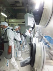 Workers secure sensitive nuclear material at one of Italy's Società Gestione Impianti Nucleari facilities in December 2013 as part of a U.S.-Italian atomic security project. The White House last year turned down a proposal to speed up its nuclear security efforts in favor of protecting nuclear-arsenal spending, according to a new report.
