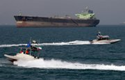 "Iranian Revolutionary Guard speedboats pass an oil tanker off the coast of southern Iran in 2012. U.S. House Foreign Affairs Committee Chairman Ed Royce (R-Calif.) on Monday urged the Obama administration to explain how it would respond if Iran and Russia finalize a ""sanctions-busting"" oil deal."