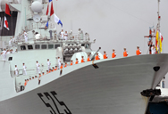 Navy sailors stand on the deck of the Chinese missile frigate Ma'Anshan as the ship docks at the port in Manila in spring 2010. A new U.S. military paper warns that Beijing might be tempted to arm its growing arsenal of cruise missiles with nuclear weapons to counter U.S. carrier strike groups.