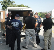 Nassau and Suffolk county law enforcement officers peer inside the trailer of a prototype nuclear-detection sensor during a 2011 Homeland Security Department test in New York. The Pentagon is funding research into a next-generation detection system that would not rely on helium 3, which is in dwindling supply.