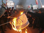 Iranian students set an Israeli flag afire during a protest to defend their country's nuclear program outside the Fordo Uranium Conversion Facility in the northern town of Qom in November. Neither Iran nor Israel has ruled out participating in a major summit to explore a ban on nuclear, chemical and biological arms from the Middle East.