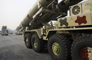 A truck carrying Brahmos missiles rolls by in January during a Indian Army Day parade in New Delhi. Both India and Pakistan are placing new highly capable cruise missiles at the center of their deterrence strategies (AP Photo/Tsering Topgyal).