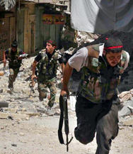 Syrian rebels run during combat with government troops on Tuesday in the city of Aleppo. The United States has yet to see any evidence of chemical-weapon attacks by opposition forces in the Syrian civil war, the White House said on Tuesday in response to a Russian forensic analysis (AP Photo/Aleppo Media Center).