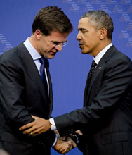 President Barack Obama shakes hands with Dutch Prime Minister Mark Rutte following a March press conference in The Hague at the end of the Nuclear Security Summit. Dutch officials have passed the role of summit leadership back to the United States after hosting this year's installment of the biennial gathering of world leaders.
