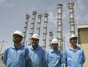Workers pose for a picture in 2006 at Iran's Arak heavy-water reactor facility. An Iranian official on Wednesday said Tehran would revamp the reactor to decrease its plutonium output.