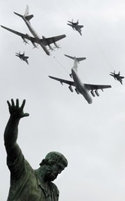 Russian MiG-29, Il-78, and Tu-95 planes fly over a statue of Russian historical figures Minin and Pozharsky in Moscow's Red Square in 2010. The U.S. military said four Tu-95 strategic bombers on Monday flew close to Alaska.