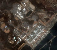 A DigitalGlobe satellite image shows the Fukushima Daiichi nuclear power plant following the March 2011 earthquake and tsunami. The commercial satellite company recently received U.S. government permission to sell its highest-resolution photographs to clients.