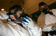 Police officers put on hazardous-materials suits to train for biological or chemical attacks in 2005. Scientists are racing to develop new procedures capable of quickly determining how chemicals and microbes attack humans at the cellular level.