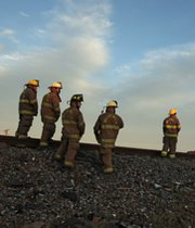 Firefighters gather near the scene of the April 2013 fertilizer-plant explosion in West, Texas. The state has stopped disclosing locations of a chemical linked to the 2013 blast.