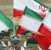 Athletes rally in support of Iran's nuclear program at the country's Natanz uranium-enrichment facility in 2006. Insiders on Wednesday said Iran is rejecting international calls to significantly scale back its uranium-enrichment capabilities.