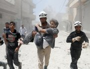 "A rescue worker carries a man following an alleged Syrian government airstrike in Aleppo last week. A global monitoring agency said Syrian fighters appear to have employed agents such chlorine in ""systematic"" attacks."