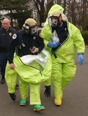 "Hazardous materials specialists in New Jersey prepare to take part in a 2005 biological terrorism exercise. The Obama administration has yet to decide whether possible warnings from a proposed national biological-weapon detection system should be classified as ""false"" if they are triggered by harmless microbial cousins of potentially dangerous disease agents, a U.S. Homeland Security Department official said this week (AP Photo/Mike Derer)."