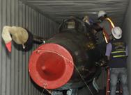 Investigators on Sunday examine a Russian-made MiG fighter jet inside a container on the North Korean-flagged freighter Chong Chon Gang. Panamanian authorities on Sunday said they had found two of the aircraft aboard the vessel intercepted earlier this month (AP Photo/Arnulfo Franco).