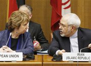 EU foreign policy chief Catherine Ashton and Iranian Foreign Minister Mohammad Javad Zarif attend a multilateral nuclear meeting in Vienna last week. Iran and the United States have urged each other to make additional concessions in multilateral negotiations on Tehran's disputed nuclear efforts.