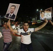 Syrians celebrate President Bashar Assad's re-election in Damascus earlier this month. Assad's government on Monday finished handing over its declared arsenal of chemical-warfare agents, an international watchdog said.