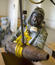 A worker handles a mock munition in March at a chemical-arms destruction facility in Germany. Officials aired concerns that chemical attacks in Syria may continue following the removal of the government's final known warfare stocks on Monday.