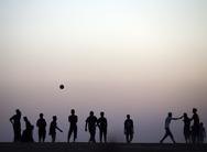 Men play soccer at a temporary displacement camp in Kalak, Iraq, amid fighting in and near Mosul on Tuesday. The U.S. State Department is expanding its social media efforts to counter Islamic State of Iraq and Syria militants and other violent extremists in key hotspots.