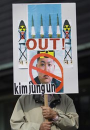 A South Korean protester displays a placard during an anti-North Korea rally in Seoul in March. North Korea on Friday announced it had successfully tested a new precision-guided tactical missile that could be used to better target the South.