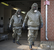 "Workers in protective clothing at a Munster, Germany, company involved in the destruction of Syrian chemical weapons, as seen in March. A senior U.S. defense official said U.S. policy toward Damascus is ""consistent"" with a new Pentagon strategy for countering weapons of mass destruction worldwide."