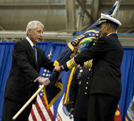 U.S. Defense Secretary Chuck Hagel passes the Strategic Command flag to Navy Adm. Cecil Haney during a change-of-command ceremony in 2013. A recent congressional audit has found that a Pentagon plan to reduce the number of senior staff assigned to the nuclear-weapons command and other military headquarters might not result in significant cost savings.