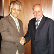 Dr. Levanthal handover to Dr. Belbesi:  The MECIDS chairmanship rotates each year among the three partners.  Here Dr. Alex Levanthal, Israel Public Health Ministry congratulates Dr. Abel Belbesi, Jordan Public Health Ministry on assuming the chairman's role in 2008.  Not pictured is Dr. Assad Ramlawi, Palestian Authority.