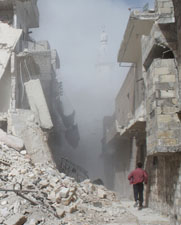 A Syrian man runs following a reported airstrike by government forces on Friday. Syria will not meet a March 15 deadline for destroying 12 chemical-arms manufacturing facilities, according to insiders at the Organization for the Prohibition of Chemical Weapons.
