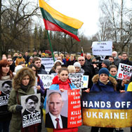 Demonstrators protest against Russia's occupation of the Crimean Peninsula on Monday in front of the Russian embassy in Vilnius, Lithuania. A number of Russia's neighbors are responding to its actions in Ukraine by looking to boost their own military capabilities.