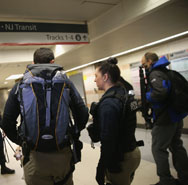 A Transportation and Security Administration officer carries radiological-nuclear detection equipment in his backpack at Penn Station in New York City in January. Efforts by the National Nuclear Security Administration to foster better international standards for safeguarding radiological sources would benefit from more outside expertise, a new report finds.