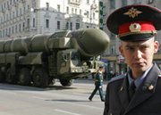 A Russian policeman guards a Topol-M ICBM during a rehearsal for the nation's Victory Day parade in Moscow in May 2008. Some have speculated that Russia may have violated an arms treaty in testing the Topol-M weapon, but others point to a cruise missile instead.