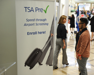 A poster advertising the Transportation Security Administration's Precheck program is seen last month at Los Angeles International Airport. TSA officials have suspended testing on a new technology that would have analyzed Precheck passengers' consumer data.
