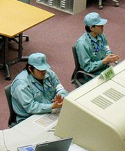 Employees work in 2004 at Japan's Rokkasho MOX facility. The United States reportedly has secretly pressed Japan to bolster security at the site, which is expected to generate plutonium of possible interest to extremists.